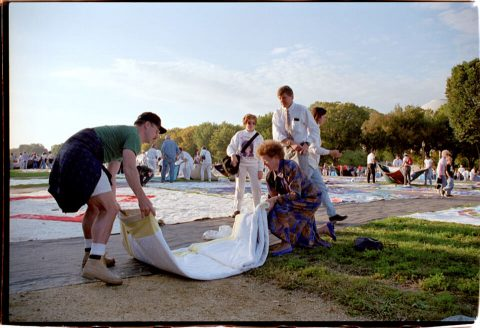 Volunteers and Family Unveil Quilt Panel. Brent Pruitt. 35mm photograph, 1996